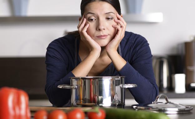 אישה במטבח (צילום: Shutterstock)