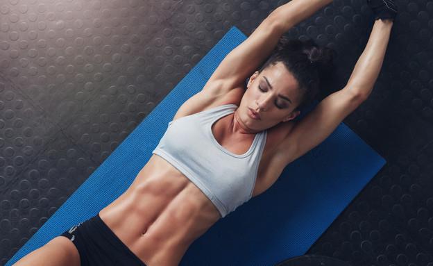 אישה באימון (צילום: Shutterstock)