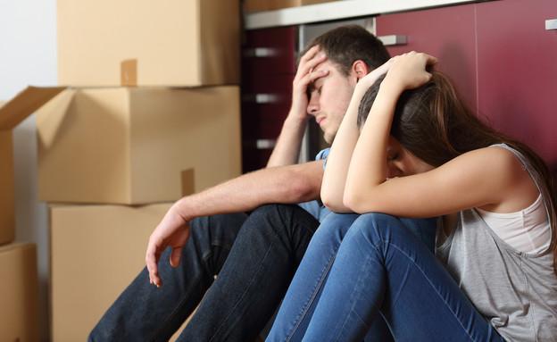 זוג מיואש מפונה מדירה (אילוסטרציה: Shutterstock)