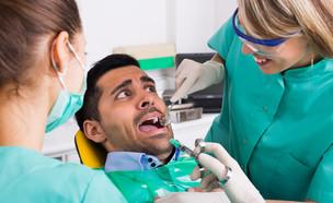 רופא שיניים (צילום: Shutterstock)
