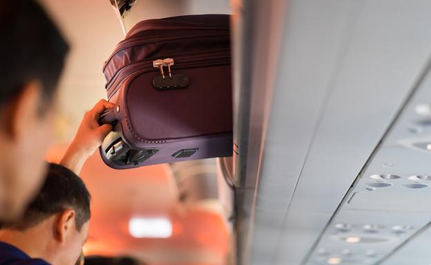 תא אחסון במטוס (צילום: Hanoi Photography, Shutterstock)