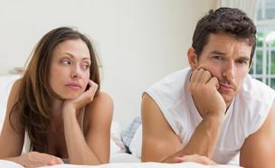 גבר ואישה במיטה (צילום: Shutterstock)