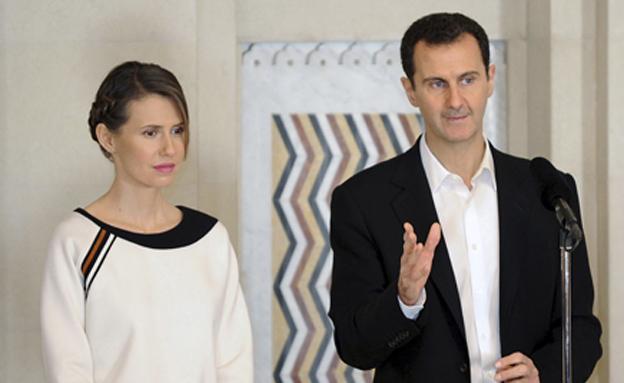 בני הזוג אסד (צילום: רויטרס)