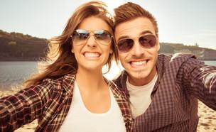 אנשים שמחים (צילום: Roman Samborskyi, Shutterstock)