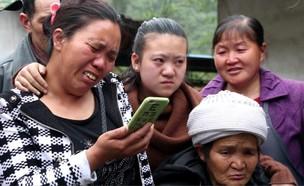 שיחת הווידאו הראשונה בין פו גואי לאימו (צילום: Baidu)