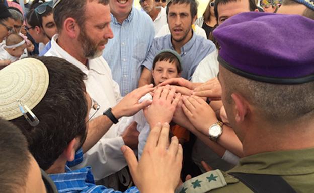 """""""במקום שאבא נרצח - אנחנו מקדשים וממשיכים (צילום: חדשות 2)"""