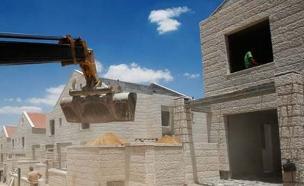 """""""הפרת החוק הבינלאומי"""". בנייה בהתנחלויות (צילום: רויטרס)"""