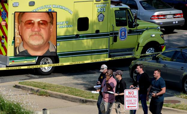 החשוד על רקע זירת הירי (צילום: רויטרס)