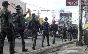 """""""ארגוני הטרור באזור התעצמו"""" (צילום: EPA/CERILO EBRANO)"""
