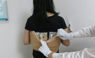 אישה שניסתה להבריח 102 אייפונים לסין (צילום:  יחסי ציבור )