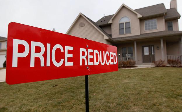 שלט מכירה על בית בפלזנט פריירי, ויסקונסין (צילום: Scott Olson, GettyImages IL)