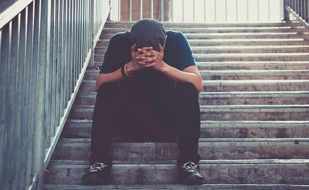 גבר מדוכא (צילום: ShutterStock)