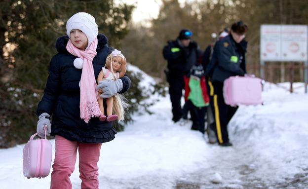 """מהגרים בגבול קנדה-ארה""""ב (צילום: רויטרס)"""