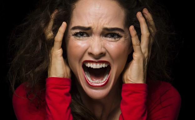 אישה צועקת (צילום: אימג'בנק / Thinkstock)