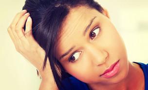 נערה חוששת (צילום: PhotoMediaGroup, Shutterstock)