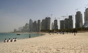 """תיירים נעצרים בקלות"""", חוף בדובאי (צילום: רויטרס)"""