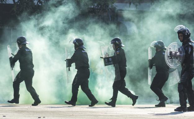 מהומות בסין (צילום: windmoon, shutterstock)
