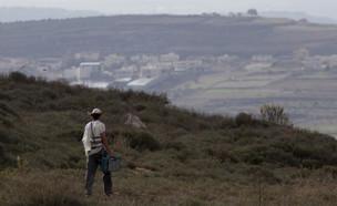 מתנחל ליד חוות גלעד (2009) (צילום: נתי שוחט, יונתן זינדל, רועי אלימה, פלאש 90)