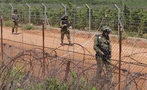 """לוחמי צה""""ל בגבול הצפון, ארכיון (צילום: רויטרס)"""