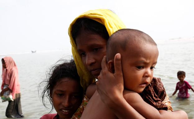פיליטים נמלטים ממיאנמר (צילום: רויטרס)