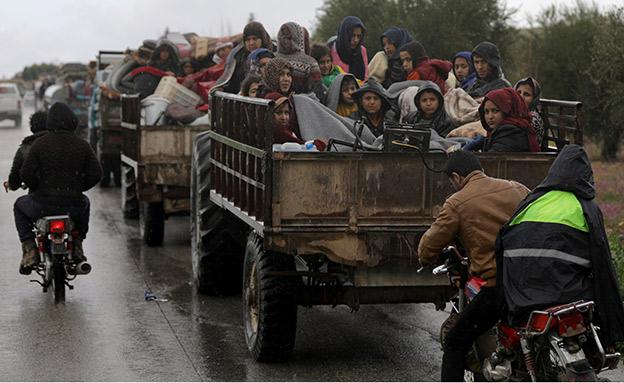 רבבות נמלטו מע'וטה (צילום: רויטרס)