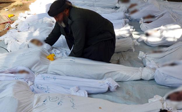 קורבנות תקיפה כימית נוספת (צילום: רויטרס)