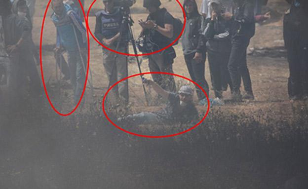 """מחבלים לצד עיתונאים. התיעוד של דו""""צ (צילום: דובר צה""""ל)"""