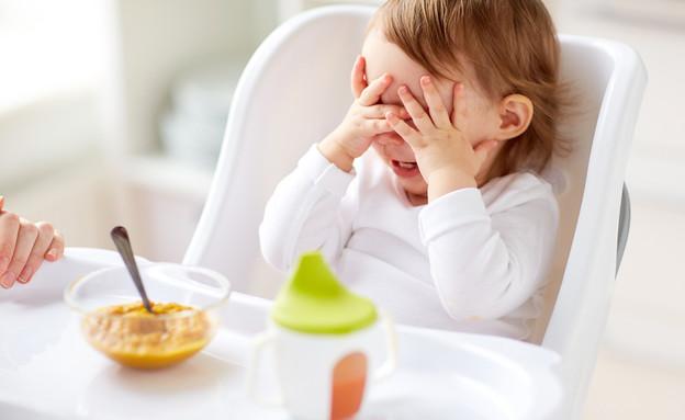 תינוקת מסרבת לאכול מחת (אילוסטרציה: kateafter | Shutterstock.com )