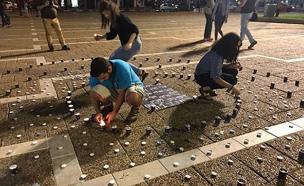 """בני מכינות מדליקים נרות זיכרון בת""""א (צילום: החדשות)"""