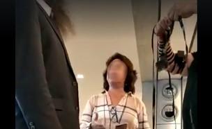 """אישה זועמת על הנחת תפילין בנתב""""ג (צילום: מתוך הפייסבוק של גד קאופמן)"""