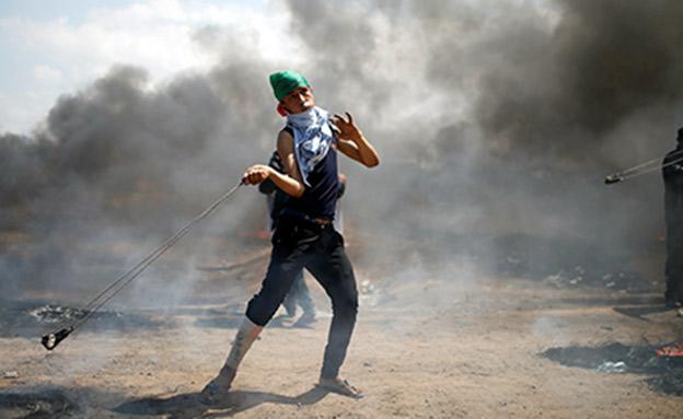 הפגנות אלימות בגבול הרצועה (צילום: רויטרס)