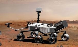 """רכב החלל """"קיוריוסיטי"""" במאדים (הדמייה) (צילום: AP)"""