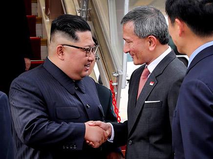 קים בפגישה עם ראש ממשלת סינגפור