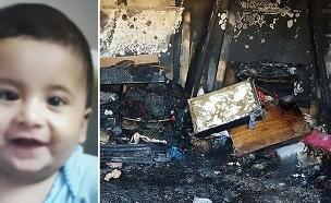 התינוק עלי דוואבשה על רקע ביתו המוצת (צילום: חדשות)