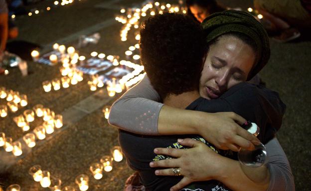 האבל בישראל לאחר מציאת גופות הנערים (צילום: רויטרס, חדשות)