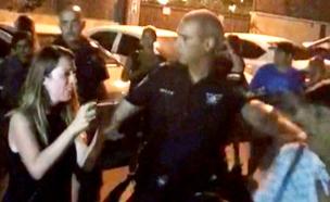 """צפו: """"אני אשים לך אזיקים מול הבת שלך"""" (צילום: באדיבות מארגני ההפגנה, חדשות)"""