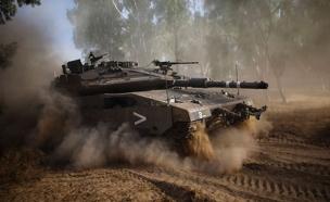 ירי טנק ברצועת עזה (ארכיון) (צילום: רויטרס, חדשות)