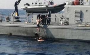 רגע הצלת האישה מהים (צילום: MORH/Coast Guard, חדשות)