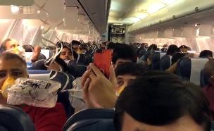 """סיוט בטיסה: """"30 דיממו מהאוזניים"""" (צילום: טוויטר, חדשות)"""