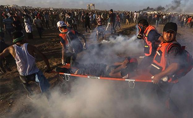 הפלסטינים: 6 נהרגו, עשרות נפצעו (צילום: חדשות)