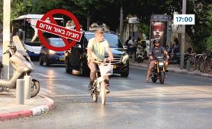 רוכב אופניים חוצה באור אדום (צילום: החדשות)