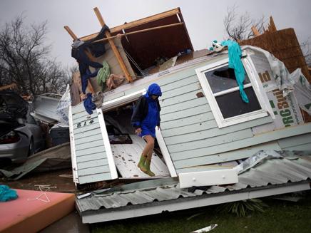 """""""בתים צפויים להיפגע"""" מזהירים (צילום: רויטרס, חדשות)"""