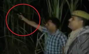 יריות בהודו (צילום: youtube/RT en Español)