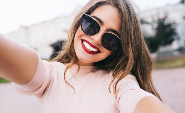 אישה במשקפי שמש (צילום: Look Studio, shutterstock)
