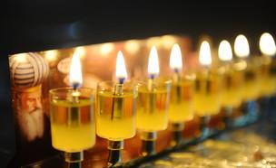 הדלקת נרות חנוכה  (צילום: Mendy Hechtman, פלאש 90)