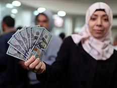 הכסף הקטרי ברצועה (ארכיון) (צילום: רויטרס)