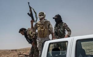 מיליציות בסוריה (צילום: Martyn Aim, gettyimages)