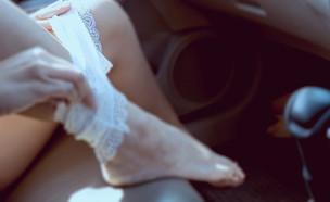 אישה ברכב (צילום: shutterstock | Pair Srinrat)