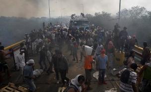 285 פצועים בעימות בגבול ונצואלה (צילום: חדשות)