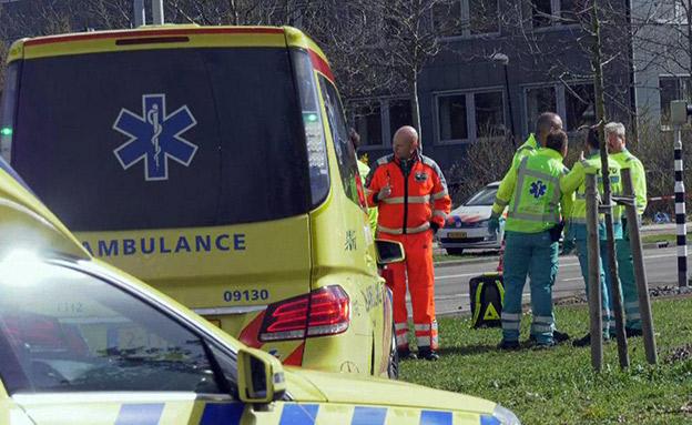 כוחות הרפואה בזירת הירי (צילום: AP, חדשות)